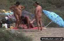 Crazy swingers fucking on a beach